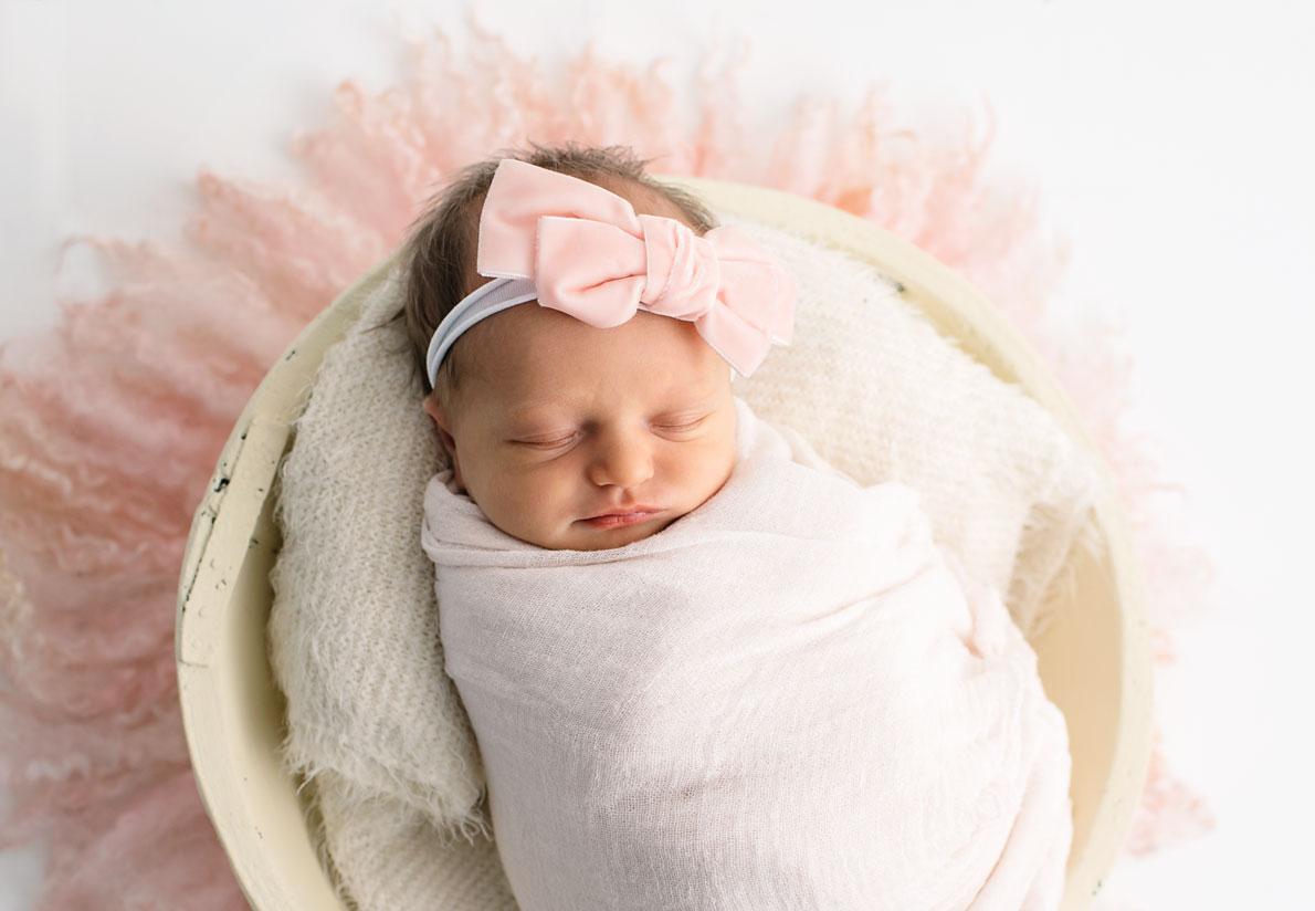 Newborn baby in pink