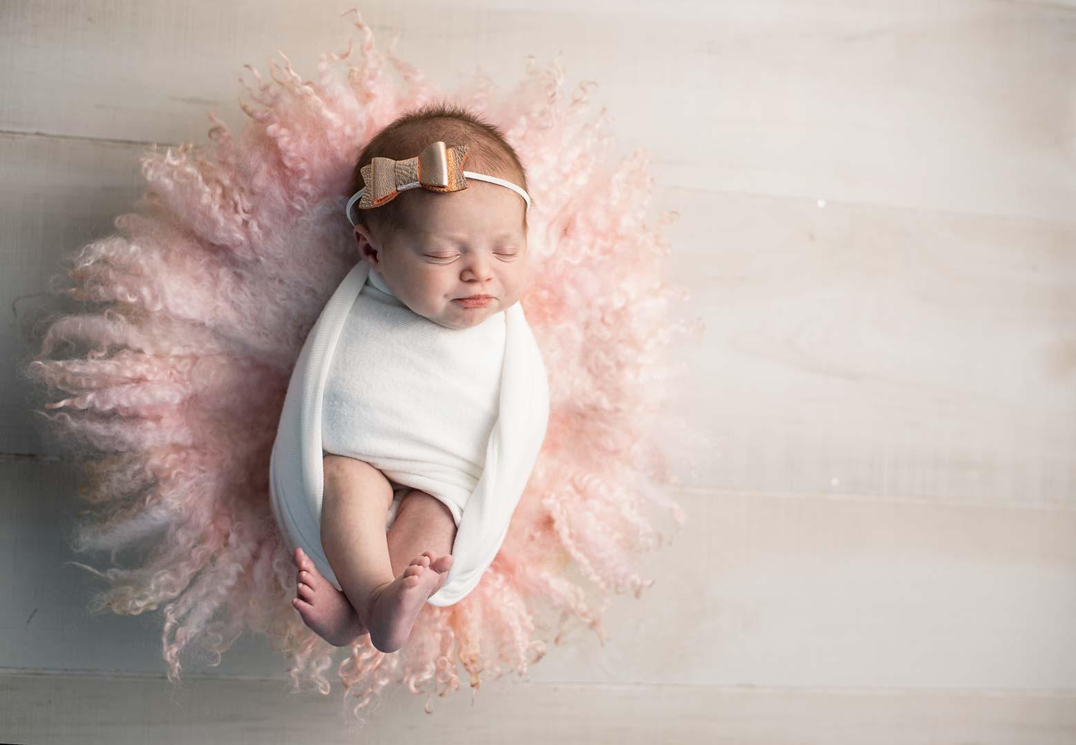Newborn baby girl in pink