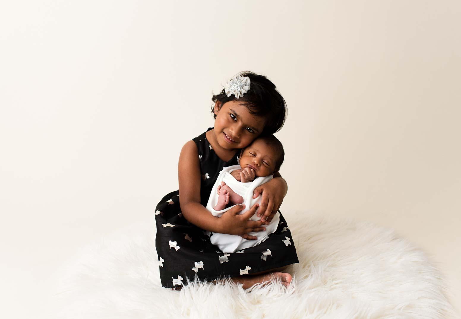Newborn Boy and Sister