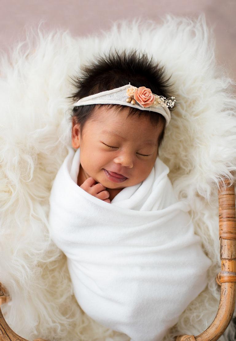 Newborn Girl Smiling